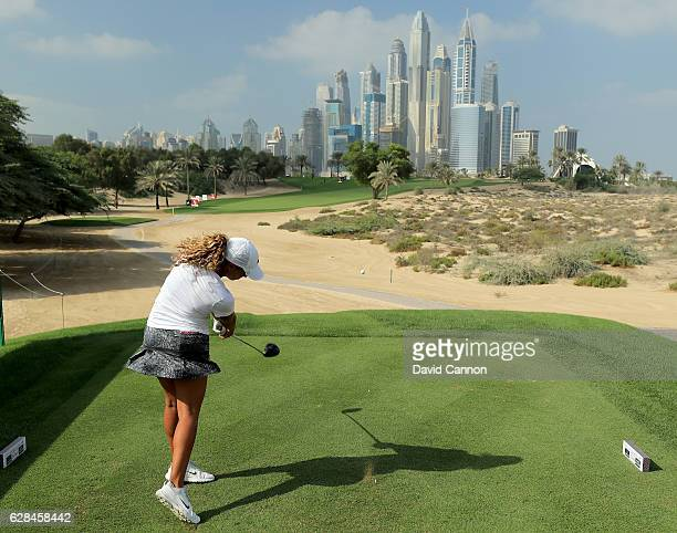 Cheyenne Woods of the United States plays her tee shot on the eighth hole during the completion of the first round of the 2016 Omega Dubai Ladies...