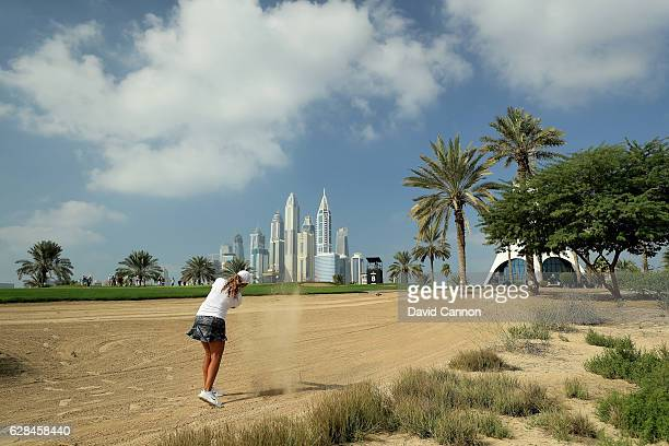 Cheyenne Woods of the United States plays her third shot on the eighth hole during the completion of the first round of the 2016 Omega Dubai Ladies...