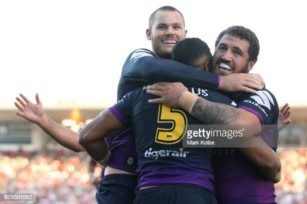 Cheyse Blair Josh AddoCarr and Kenny Bromwich of the Storm celebrate Josh AddoCarr scoring a try during the round nine NRL match between the St...