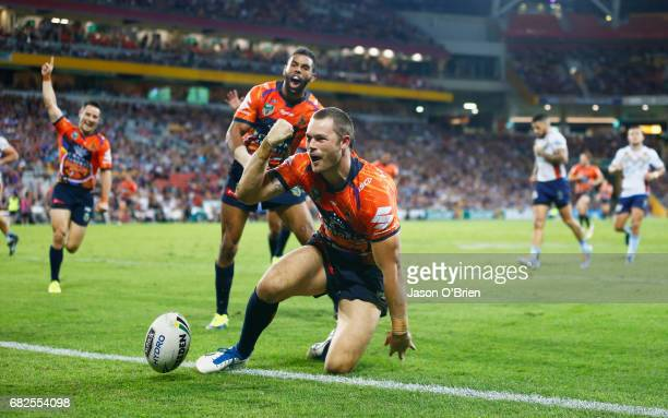 Cheyse Blair of the Storm celebrates scoring a try during the round 10 NRL match between the Melbourne Storm and the Gold Coast Titans at Suncorp...