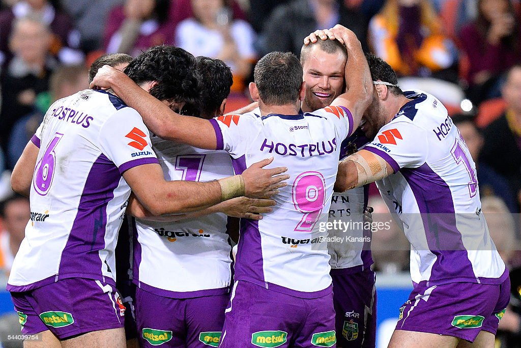 Cheyse Blair of the Storm is congratulated by team mates after scoring a try during the round 17 NRL match between the Brisbane Broncos and the Melbourne Storm at Suncorp Stadium on July 1, 2016 in Brisbane, Australia.