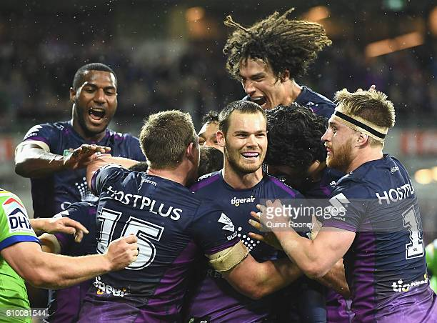Cheyse Blair of the Storm is congratulated by team mates after scoring a try during the NRL Preliminary Final match between the Melbourne Storm and...