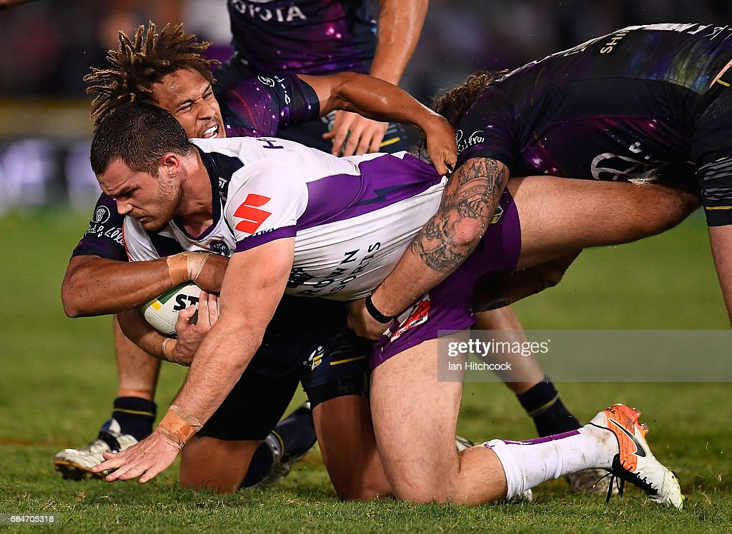Cheyse Blair of the Storm is tackled by Ray Thompson of the Cowboys during the round 21 NRL match between the North Queensland Cowboys and the Melbourne Storm at 1300SMILES Stadium on July 30, 2016 in Townsville, Australia.