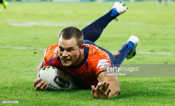 Cheyse Blair of the Storm scores a try during the round 10 NRL match between the Melbourne Storm and the Gold Coast Titans at Suncorp Stadium on May...