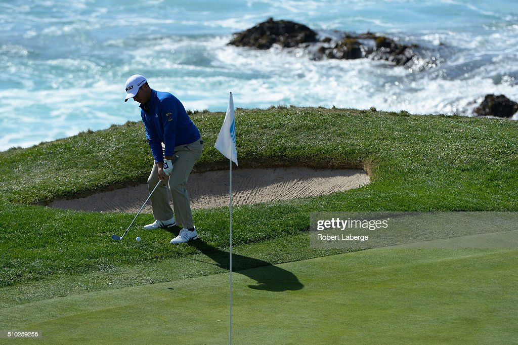 Chez Reavie chips onto the seventh green during the final round of the AT&T Pebble Beach National Pro-Am at the Pebble Beach Golf Links on February 14, 2016 in Pebble Beach, California.