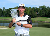 Chez Reavie holds the trophy after winning the Small Business Connection Championship at River Run held at River Run Country Club on September 20...