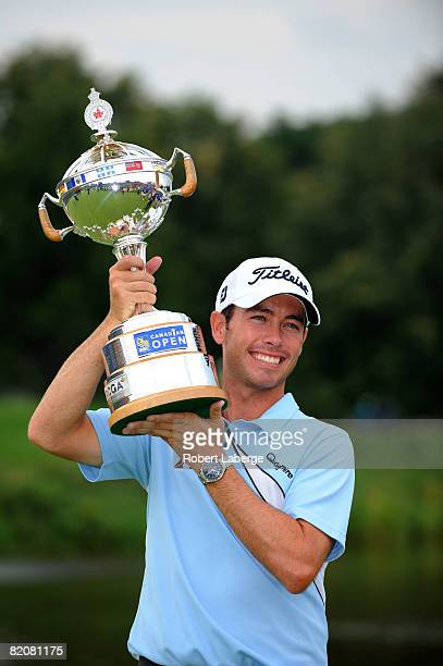Chez Reavie lifts the winner's trophy after winning the RBC Canadian Open at the Glen Abbey Golf Club on July 27 2008 in Oakville Ontario Canada
