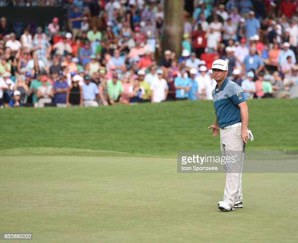Chez Reavie reacts to his putt not breaking on the 18th green during the final round of the PGA Championship on August 13 2017 at Quail Hollow Golf...