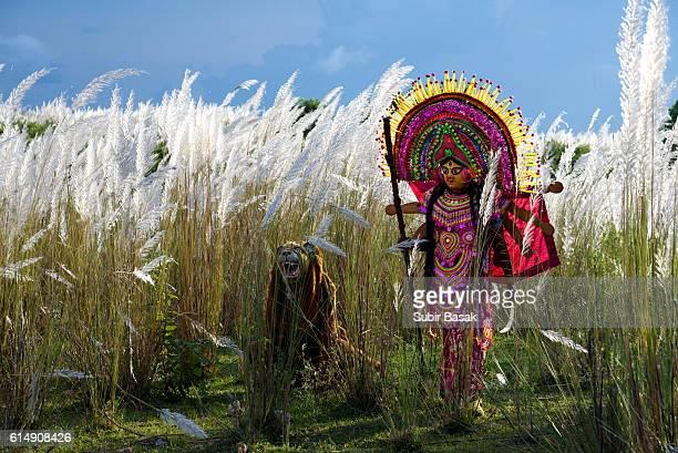 Chhau (Mask) Dancers act as Debi Durga and  performing at  Purulia, West Bengal,