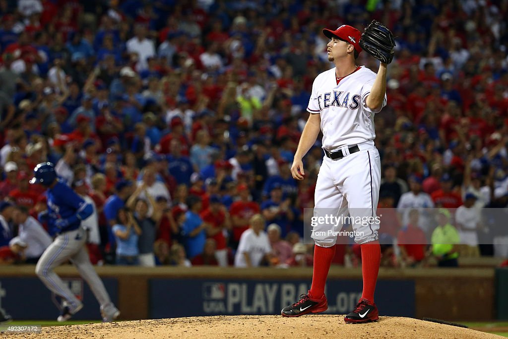 Chi Chi Gonzalez #21 of the Texas Rangers looks on after giving up a three run home run to Troy Tulowitzki #2 of the Toronto Blue Jays in the sixth inning during game three of the American League Division Series on October 11, 2015 in Arlington, Texas.