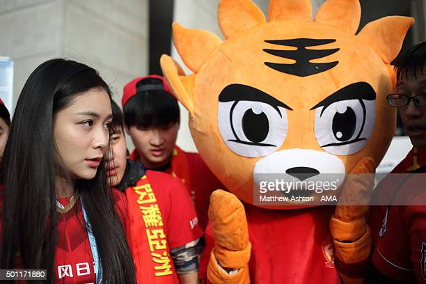 Chi Shuxin TV Presenter from Ten Cent ChinaTV covering Guangzhou Evergrande FC with mascot Tiger before the FIFA Club World Cup quarter final between...