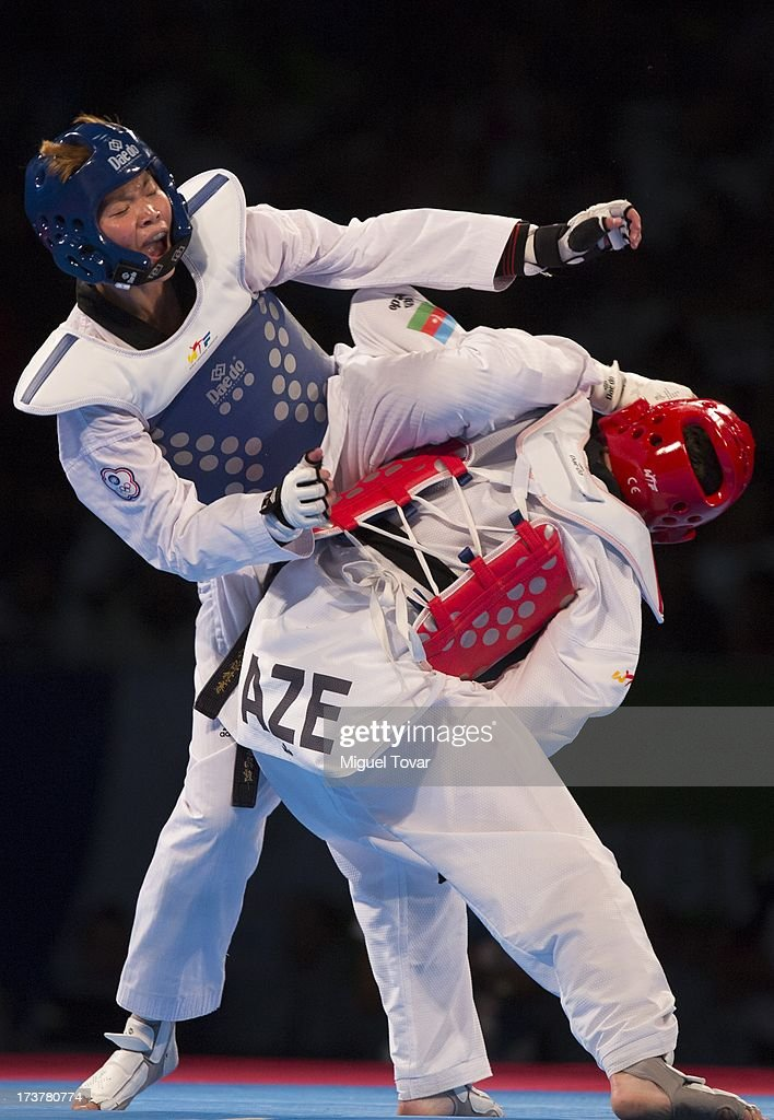 Chia Chia Chuang of Chinese Taipei (blue) competes with Farida Azizova of Azerbaijan during a Wome's -67 kg combat of WTF World Taekwondo Championships 2013 at the exhibitions Center on July 17, 2013 in Puebla, Mexico.