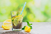 Chia fresca drink with lemon and mint in tall glasses. Copy space