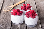 Chia pudding in glass with raspberry . Breakfast yogurt