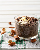 chia pudding with chocolate banana smoothie in a glass jar on the old wooden background