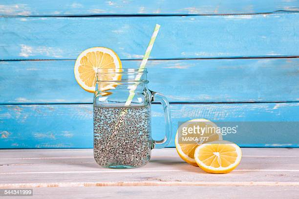 Chia seeds energy drink on blue wood background