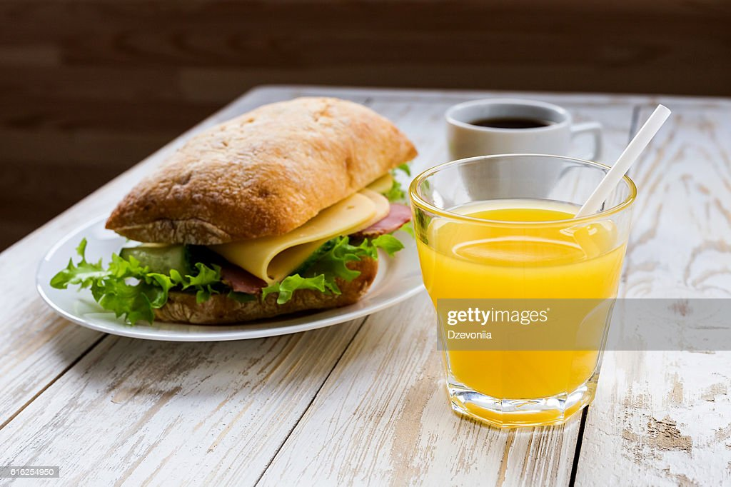 Chiabatta sandwich, cup of coffee and orange juice : Stock Photo