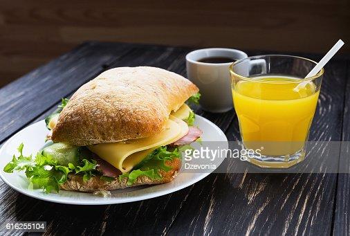 Chiabatta sandwich, cup of coffee and orange juice : Stock Photo