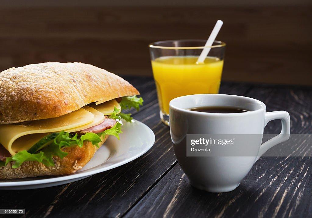 Chiabatta sandwich, cup of coffee and orange juice : Foto de stock