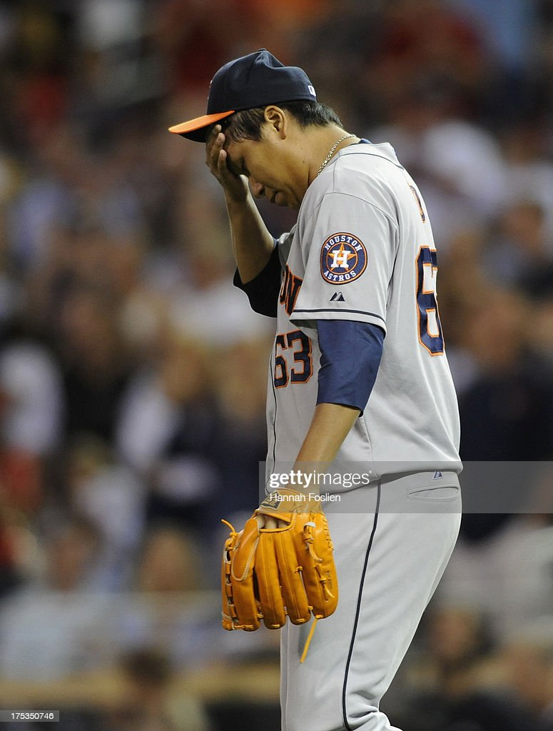 Chia-Jen Lo #63 of the Houston Astros reacts during the ninth inning of the game against the Minnesota Twins on August 2, 2013 at Target Field in Minneapolis, Minnesota. The Twins defeated the Astros 4-3 in thirteen inning.