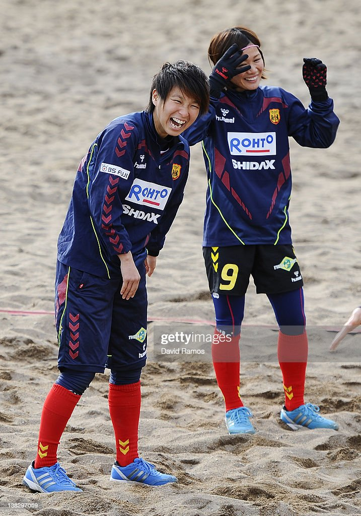Chiaki Minamiyama (L) and Nahomi Kawasumi of INAC Kobe Leonessa Ladies laugh during a training session at the Club Natacion Barcelona sport complex in La Barceloneta beach on February 5, 2012 in Barcelona, Spain.