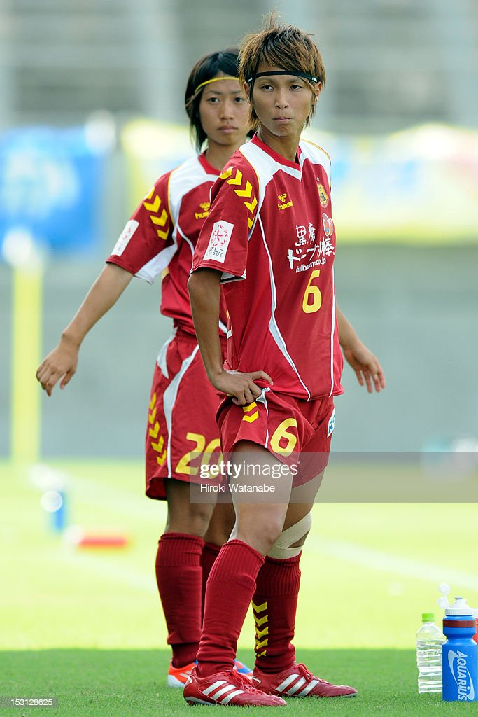 Chiaki Minamiyama (R) and Yoko Tanaka of INAC Kobe Leonessa look on during the Nadeshiko League match between AS Elfen Sayama and INAC Kobe Leonessa at NACK 5 Stadium Omiya on September 30, 2012 in Saitama, Japan.