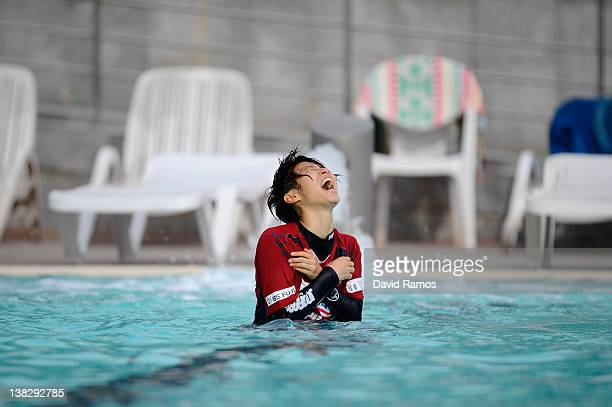 Chiaki Minamiyama of INAC Kobe Leonessa Ladies reacts to the water temperature after being thrown into an outdoor swimming pool by her teammates...