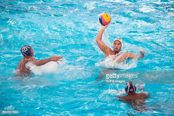 Chiam Kun Yang of Singapore attacks against Indonesia in the men's water polo round robin match during the South East Asian Games in Kuala Lumpur...