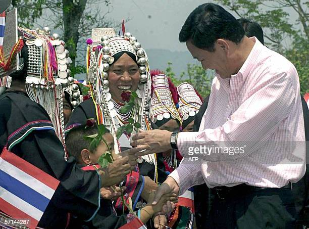 Thai Prime Ministter Thaksin Shinawatra recieves flowers from hill tribe supporters during of his election campaign rally in Chiang rai province...