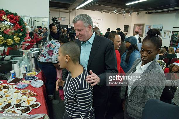 Chiara and Bill de Blasio greet servers at the dessert table as they prepare to help serve the holiday meal New York City Mayor Bill de Blasio and...