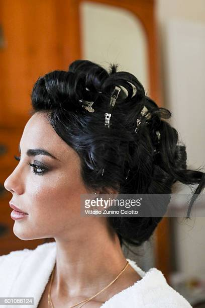 Chiara Biasi gets her hair done at L'Oreal Professionnel backstage during the 73rd Venice Film Festival on September 8 2016 in Venice Italy