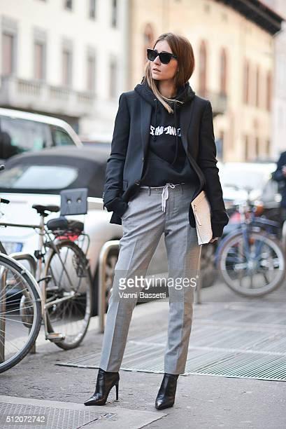 Chiara Capitani poses wearing a Fucking Awesome sweatshirt and Loewe bag before the Alberta Ferretti show during the Milan Fashion Week Fall/Winter...