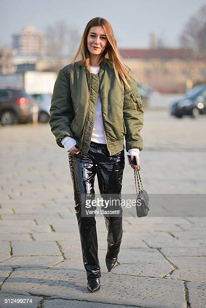 Chiara Capitani poses wearing a vintage bomber jacket Diesel Black Gold pants and Chanel bag before the Diesel Black Gold show during the Milan...