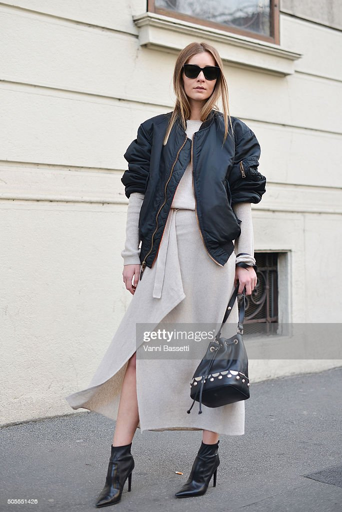 Chiara Capitani poses wearing a vintge bomber jacket Stefanel dress and Diesel Black Gold bag before the Etro show during the Milan Men's Fashion...