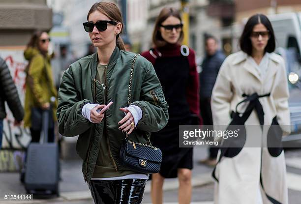Chiara Capitani wearing a black Chanel back and a green bomber jacket seen outside Sportmax during Milan Fashion Week Fall/Winter 2016/17 on February...