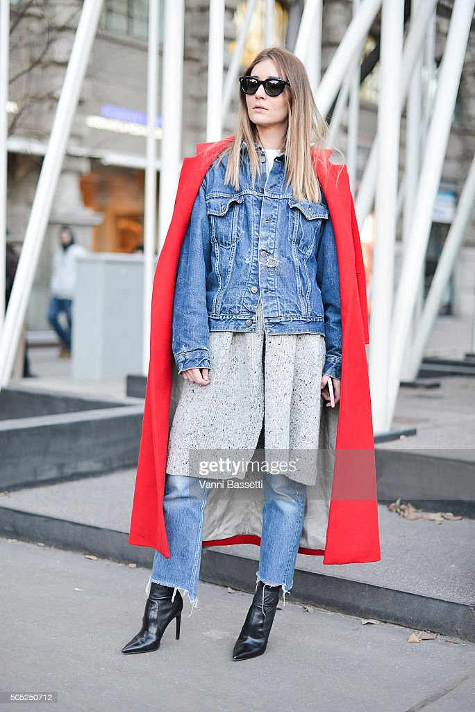 Chiara Capitoni poses wearing an Annie P coat and Levis jacket and pants after the Jil Sander show during the Milan Men's Fashion Week Fall/Winter 2016/17 on January 16, 2016 in Milan, Italy.