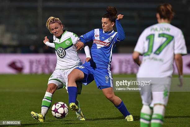 Chiara Eusebio of Brescia competes with Julia Simic of Wolfsburg during the UEFA Women's Champions League Quarter Final match between Brescia and...