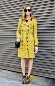 Chiara Ferragni blogger and shoe designer from Italy seen outside the Ralph Lauren show wearing a Burberry trench coat Valentino bag Louboutin shoes...