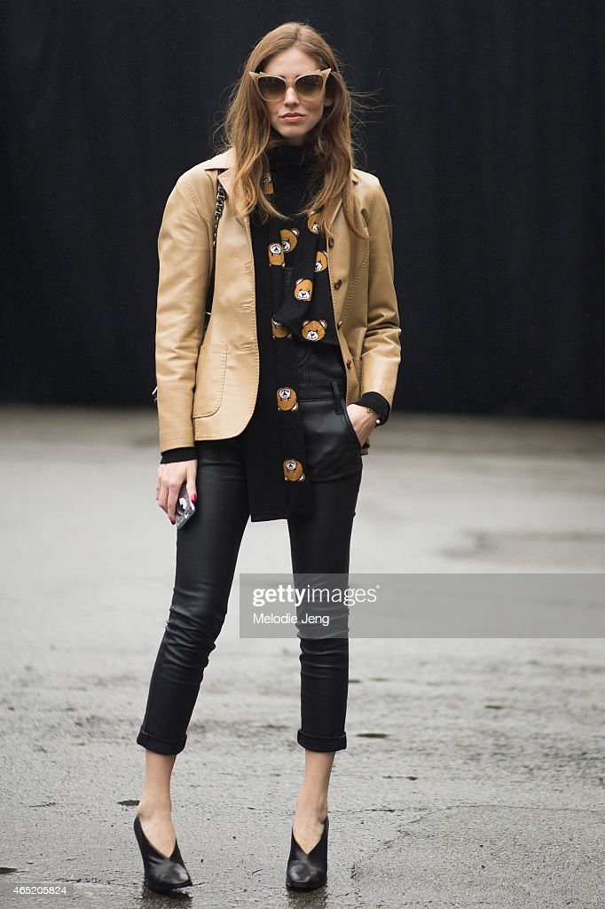 Chiara Ferragni exits the Dsquared2 show in Dita eyewear a vintage jacket Black Orchid leather overalls Moschino scarf and sweater Celine shoes and a...