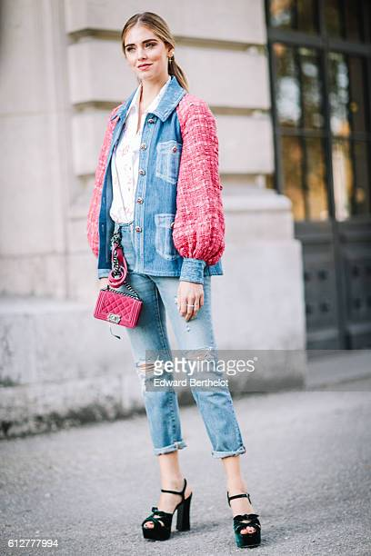Chiara Ferragni is wearing blue denim jeans a pink and blue denim jacket and a pink Chanel bag outside the Chanel show during Paris Fashion Week...