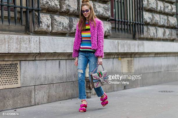 Chiara Ferragni is wearing pink Marco De Vincenzo heel sandals The Blonde Salad for Levi's ripped jeans Gucci sweater and bag pink Philosophy fur...