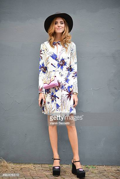 Chiara Ferragni poses wearing a MSGM dress and Paula Cademartori bag before the MSGM show during the Milan Fashion Week Spring/Summer 16 on September...