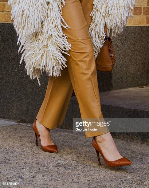 Chiara Ferragni seen at Skylight Clarkson Sq outside the Ralph Lauren show wearing white shag wool coat and leather pants during New York Fashion...
