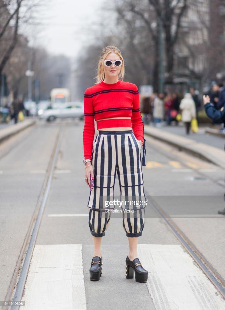 Chiara Ferragni wearing a red knit, striped pants from Fendi outside Fendi during Milan Fashion Week Fall/Winter 2017/18 on February 23, 2017 in Milan, Italy.