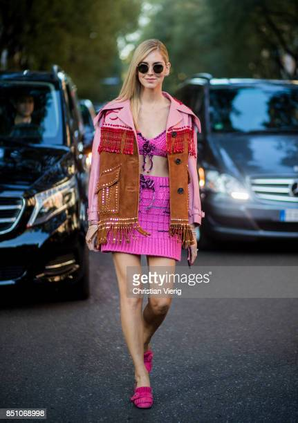Chiara Ferragni wearing pink skirt and top jacket with fringes is seen outside Prada during Milan Fashion Week Spring/Summer 2018 on September 21...