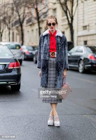 Chiara Ferragni wearing red blouse grey plaid long skirt white heel shoes and a grey fur coat and bag from Miu Miu outside Miu Miu during the Paris...
