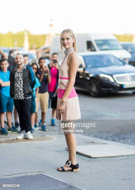 Chiara Ferragni wearing sandals dress and clutch outside Miu Miu Cruise Collection during Paris Fashion Week Haute Couture Fall/Winter 20172018 Day...