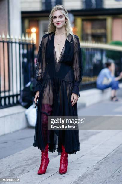 Chiara Ferragni wears a black lace mesh dress and thigh high red leather boots before the Fendi show during Paris Fashion Week Haute Couture...