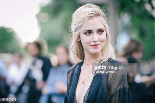 Chiara Ferragni wears a black lace mesh dress outside the Fendi show during Paris Fashion Week Haute Couture Fall/Winter 20172018 on July 5 2017 in...