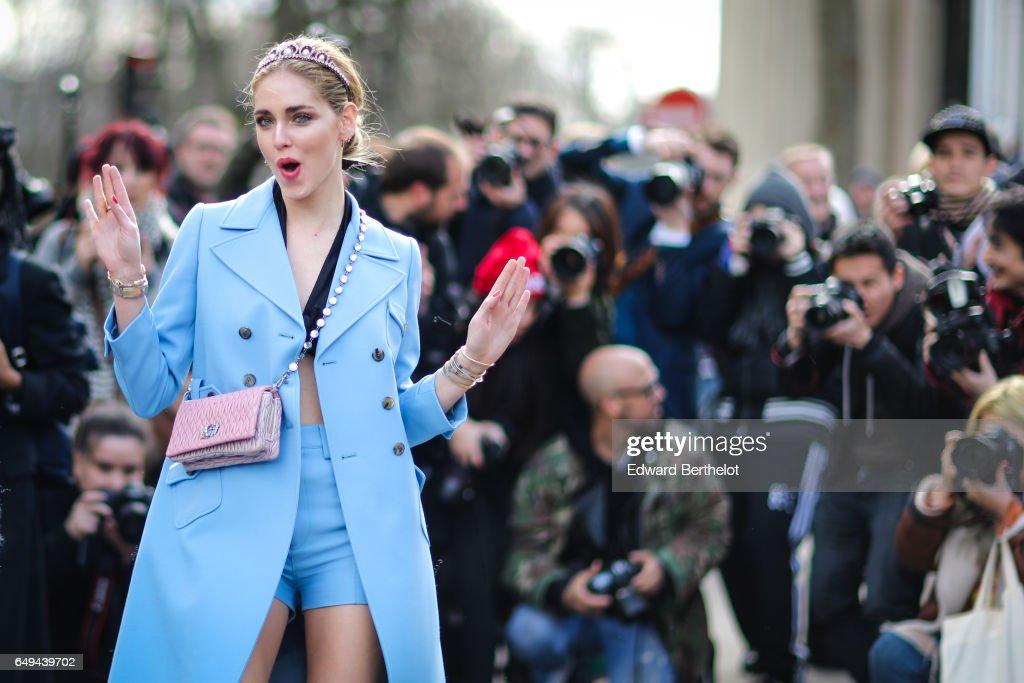 Chiara Ferragni wears a blue coat, and a pink bag, outside the Miu Miu show, during Paris Fashion Week Womenswear Fall/Winter 2017/2018, on March 7, 2017 in Paris, France.